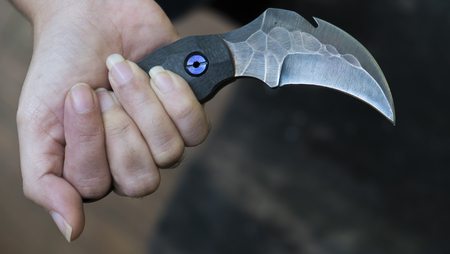 Knife in the hands, karambit knife tactical fighter, self defense Martial Arts Fighting