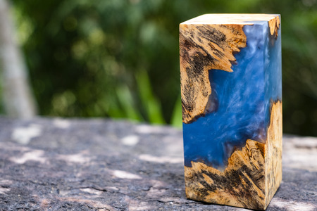 Casting epoxy resin Stabilizing burl Afzelia wood abstract art background for blanks