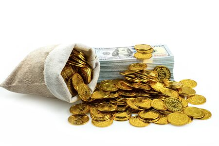 Stack bundles of 100 US dollars banknotes and gold coin in treasure sack on white background, Money stack for business planning investment and saving future concept