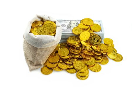 Stack bundles of 100 US dollars banknotes and gold coin in treasure sack on white background, Money stack for business planning investment and saving future concept Banque d'images