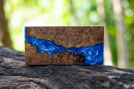 Casting epoxy resin Stabilizing persimmon burl wood abstract art background