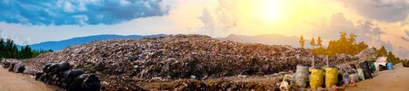 Mountain large garbage pile and pollution, Pile of stink and toxic residue, These garbage come from urban and industrial areas can not get rid of, Consumer society Cause massive waste