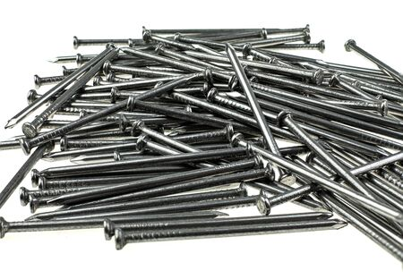 Pile of iron nails at white background