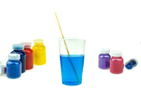 Mixing color epoxy resin in plastic cup for casting Stabilizing wood and pine cone hybrid