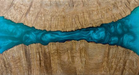 Casting epoxy resin Stabilizing Afzelia burl wood blue abstract art background texture for blanks