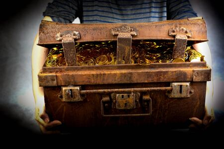 Stacking Gold Coin in treasure chest  on black background