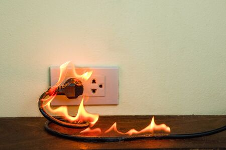 On fire electric wire plug Receptacle wall partition, Electric short circuit failure resulting in electricity wire burnt Reklamní fotografie