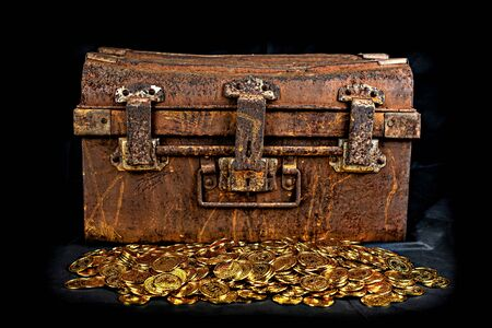 Stacking Gold Coin in treasure chest  old on black background Archivio Fotografico