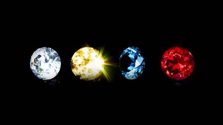 Gruppe schöner Diamant in blau-rot-gelb und klar auf isoliertem schwarzem Hintergrund