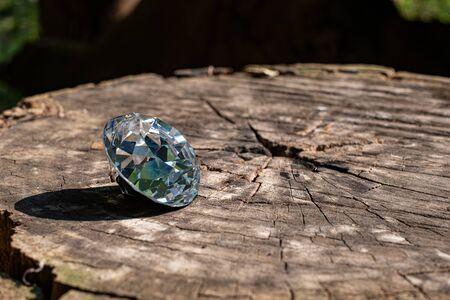 Dazzling round diamond at wood background