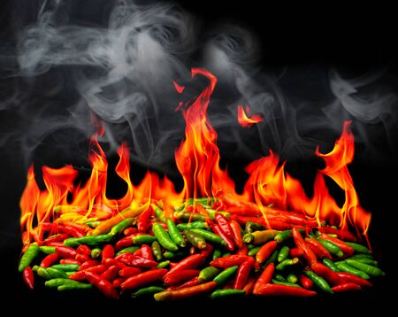 Group of Red Hot chili pepper on fire and smoke at black background