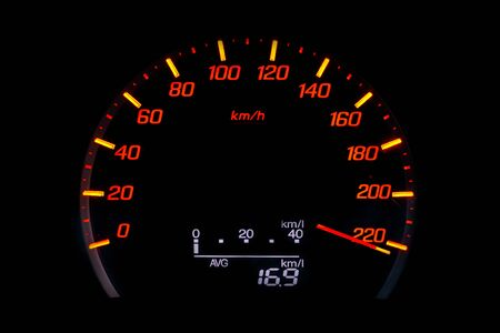 Close up of car speedometer with the needle pointing a high speed at blackground, Speedometer with a red arrow indicating speeding, conceptual image for excessive speeding or careless driving concept