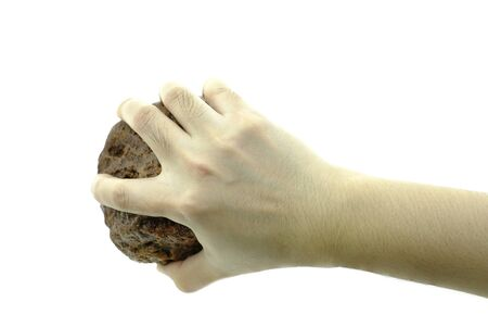 Close up hand is holding stone isolated at white background