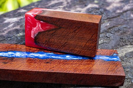 Nature wood with casting epoxy resin blue and red and stabilizing art for DIY