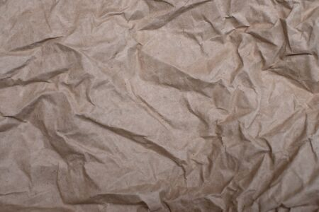 Close up crumpled creased paper old texture background for design
