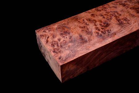 Logs Burma Padauk burl wood striped exotic wooden beautiful pattern for crafts at black background