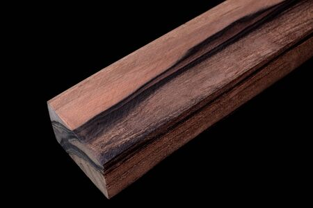 Logs of Persimmon wood beautiful pattern for crafts at the black background Фото со стока