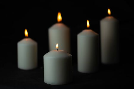 Five light flame candle burning brightly on black background