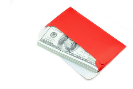 Money 100 Us dollar bills in a red envelope at white background, The concept Ang Pao or Chin Sok of Chinese New Year100,
