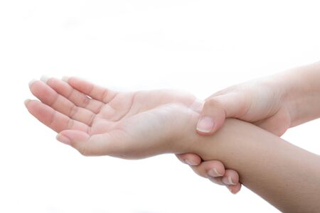 The woman holds on to the sore wrist at white background, Inflamed hand Imagens