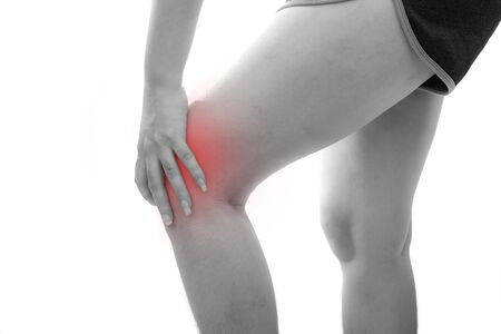 Young Asian woman with Knee pain at white background, Health problem discomfort concept