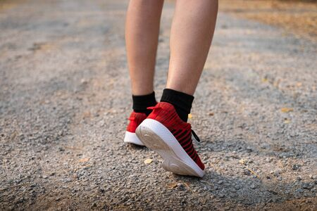 Photo back view sporty Asian young woman wear sports shoes running on asphalt road, Fitness and workout wellness, Healthy lifestyle concept