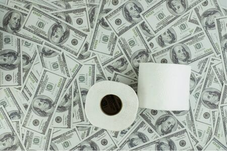 Toilet paper tissue and money of stack 100 US dollars banknote a lot of texture background, That was It costs expensive price and high priced products concept, top view, high angle