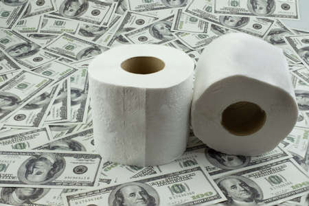 Toilet paper tissue and money of stack 100 US dollars banknote a lot of texture background Stock Photo