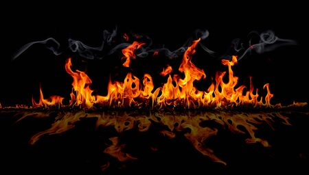 On fire flames at the black background, Burning red hot sparks rise, Fiery orange glowing flying particles
