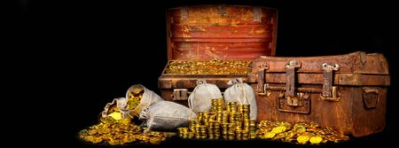 Stacking gold Coin in a treasure old steel chest a lot of on black background
