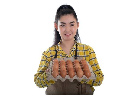 Beautiful young woman hand holding eggs carton with chicken egg lined up in rows at white background Standard-Bild - 144045040