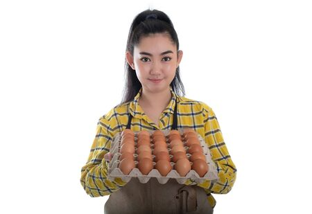 Beautiful young woman hand holding eggs carton with chicken egg lined up in rows at white background