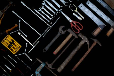 Photo top view a huge set collection of working hand and power tools many for the wooden on black background, Toolset with interior,  do-it-yourself  DIY tool, kit flat style, Stock hardware
