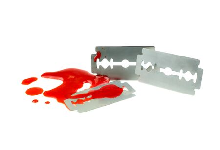 Photo of 3 Razor blade with a drop of blood on white background