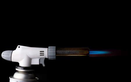 Gas burner with blue fire flame at black background Banco de Imagens