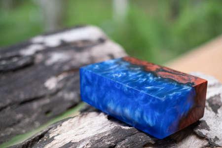 Casting epoxy resin padauk burl wood on the table