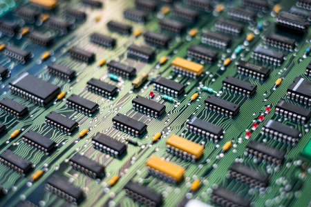 Closeup Electronic circuit board ( PCB )components detail and An integrated circuit (ic)