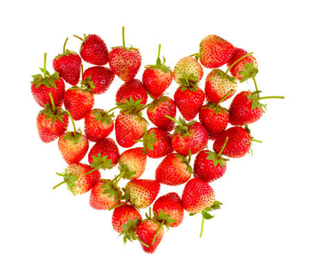 Fresh strawberries in a heart shape isolated on white background Stockfoto