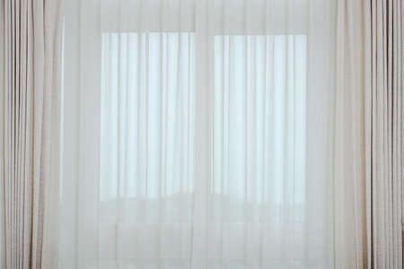 Soft brown curtains interior decoration with morning light from the window