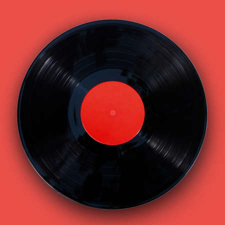 Gramophone vinyl record isolated at the  orange background with clipping path