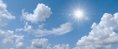 Beautiful clear blue sky with white clouds and sun