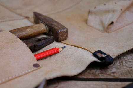 Collection of woodworking old hand tools in leather apron on a rough workbench wooden Standard-Bild