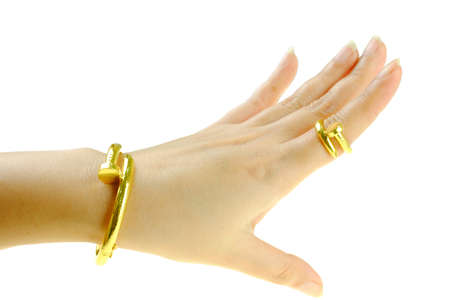 Beautiful woman hand put a gold bracelet and ring jewelry isolated on white background