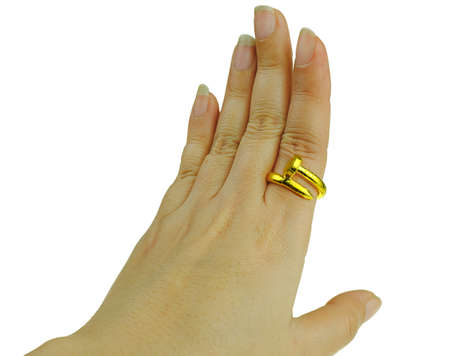Beautiful woman hand put a gold ring jewelry isolated on white background