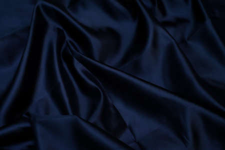 Closeup of smooth elegant black silk fabric luxury cloth texture can use as background