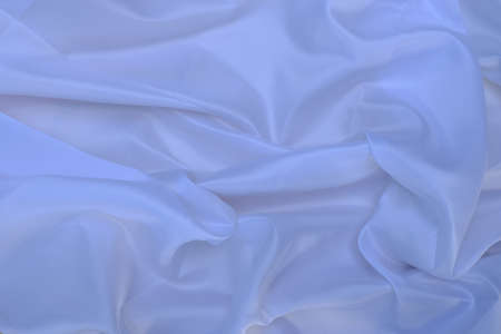 Closeup of smooth elegant white silk fabric luxury cloth texture can use as background Archivio Fotografico