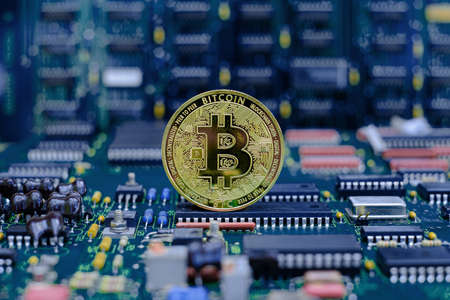 Golden bitcoin cryptocurrency new version on computer electronic circuit board background Archivio Fotografico