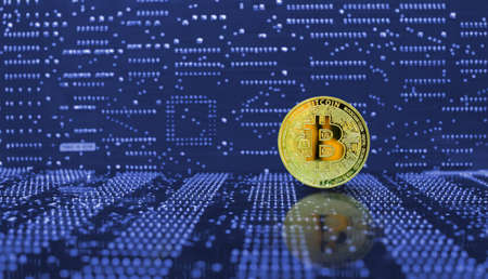 Golden bitcoin cryptocurrency on computer electronic circuit board background