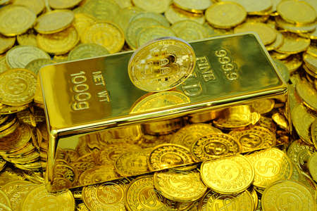 Bitcoin cryptocurrency on the gold bar and pile gold coin