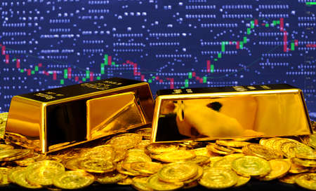 Gold bullion on at computer trading chart background